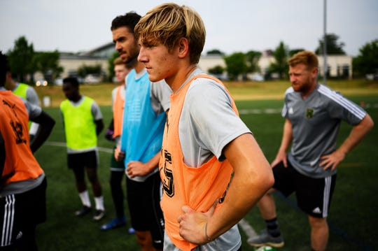Conor Dowler, a junior at TL Hanna, listens to head coach Lee Squires during Greenville FC practice at the Kroc Center Wednesday, June 5, 2019.