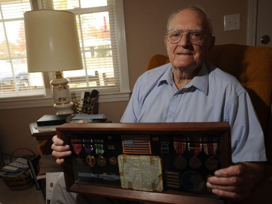 Harry Duvall talks to The Greenville News about serving in the military during World War II on Thursday, Nov. 10, 2011.