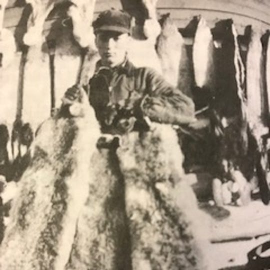 Laurence Pilgeram displays three coyotes he shot in February 1942. Pilgeram ran a trap line and raised cattle to help fund his college education.