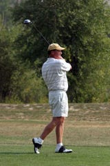 """Steve """"Curly"""" Williamson golfs in the 17th annual Montana Mid-Amateur golf tournament at Marias Valley Golf and Country Club in 2003. He's launched a new era at the Shelby 18-hole course."""