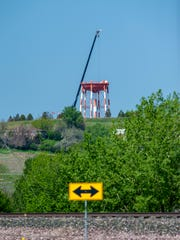 The old red and white water tower on Gore Hill disappeared peace by peace beginning in late May.