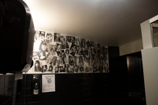 Longin and Fought's wives decorated the women's bathroom with the women of rock and roll.