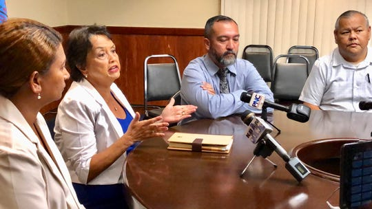 Gov. Lou Leon Guerrero, second from left, gestures on June 5, 2019 as she talks about short-term and long-term solutions to address violence in the community in the wake of machete attacks in Mangilao. Looking on are Federated States of Micronesia Consul Teresa Filepin, Sen. Clynton Ridgell, and Police Chief Stephen Ignacio, right.