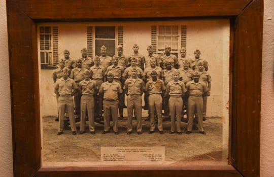 A photo of Jesus Babauta, front row, third from right, with his Advance Food Service Course classmates, during his time in the Marine Corps.