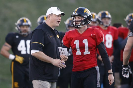 Ryan Boyle, right, works with Iowa offensive coordinator Brian Ferentz during an April 2017 practice. Two months later, Boyle was officially a graduate transfer to Indiana State.
