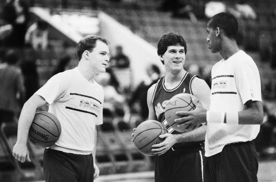Scott Skiles of the Pacers (from left), Steve Alford of the Mavericks and Reggie Miller on Dec. 23, 1987 at Market Square Arena.