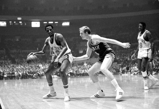 Dick van Arsdale, right, of the Phoenix Suns come in on the play from behind as New York Knicks' Dick Barnett prepares to move out with the ball in their game at New York's Madison Square Garden, Oct. 21, 1969. New York won, 140-116.