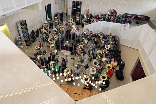 Several dozen conference participants gathered for this early-morning warm-up class in the basement level Dusdieker Student Commons during the international conference. In all, some 750 tuba and euphonium players came to Iowa City for the week-long event.