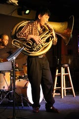 The Mill in downtown Iowa City rocked with tuba performances as participants unwound from their conference schedule. This performer plays a helicon in the jazz competition.