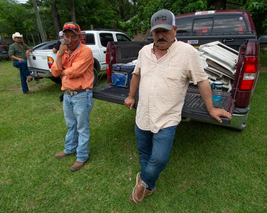 Rufino Lugo Trejo (center) and Nazario Casas (right) of Macon, Miss. are family of 8 men killed in a head-on collision Monday on highway 16 near Scooba, Mississippi. Tuesday, May 4, 2019.