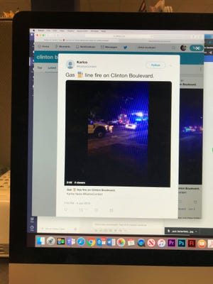 This photo of a computer screen shows emergency vehicles at a vehicle crash and gas line explosion in a social media post.