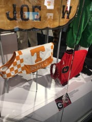 College Football Hall of Fame includes jacket worn by Smokey IX, Tennessee football's mascot. It is next to one worn by Georgia's bulldog, Uga.