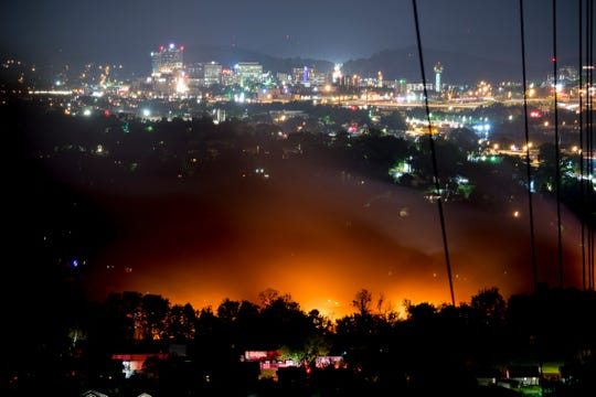 A fire continues to burn into the night at Fort Loudon Waste & Recycling in North Knoxville, Tennessee on Wednesday, May 1, 2019.