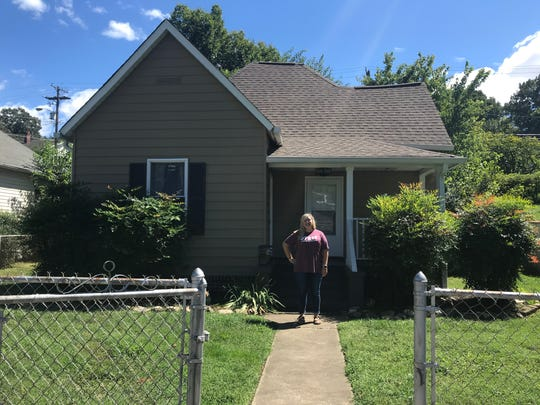 Darrian Bruce stands outside her home in Knoxville. Bruce, a teacher at Fulton High School, purchased her house in September.