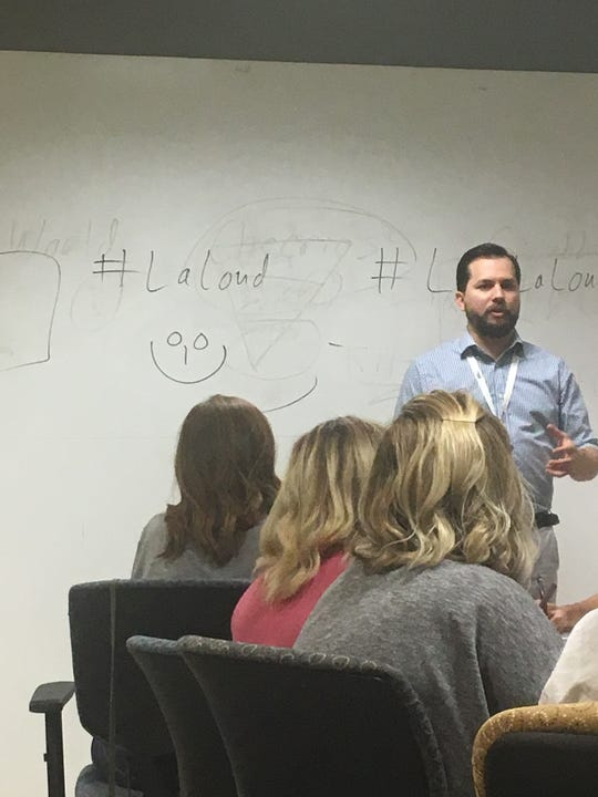 It was all smiles at Small Business Boot Camp as Destin Ortego, director of OM, explains how to create engaging content.