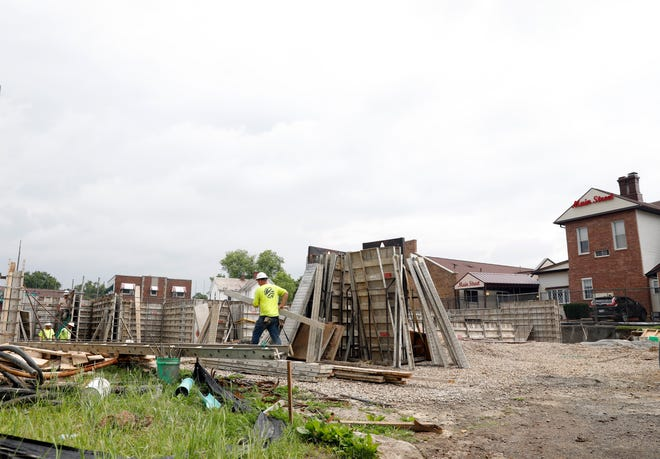 Construction crews work on the creating concrete forms for a new more than 10,000 square foot addition to Main Street Terrace Care Center Wednesday, June 5, 2019, in Lancaster.