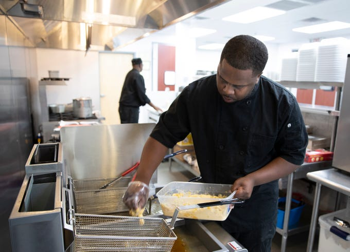 Deonte Peden works on a batch of fried green tomatoes at Dasha Barbour Southern Bistro, a new restaurant in the Russell neighborhood. June 5, 2019.
