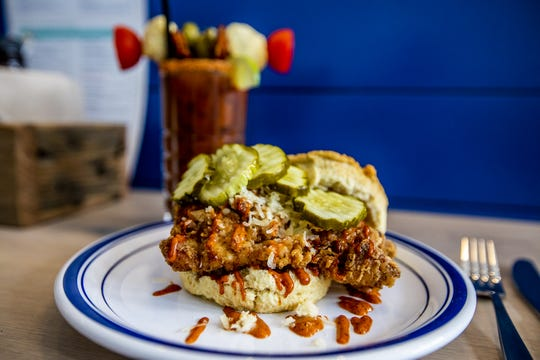 The Fire in your Belly biscuit at Biscuit Belly is served fried chicken, Nashville hot aioli, cheddar and pickles. June 5, 2019