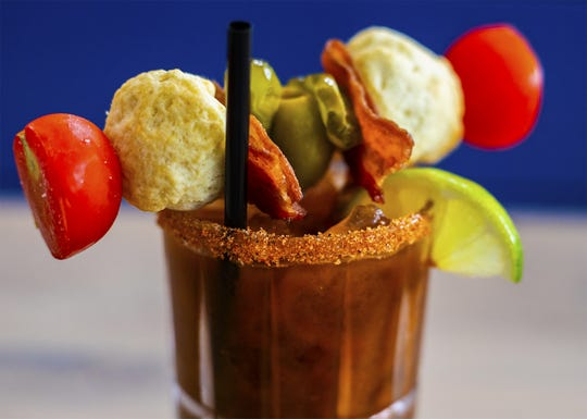 The Dark and Spicy Bloody Mary at Biscuit Belly is made with a house-mixed mole sauce and garnished with lime, tomatoes, pickles, olives, bacon and of course, tiny biscuits. June 5, 2019