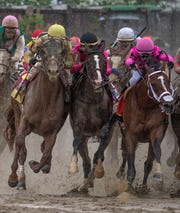 Left to right; Country House, War of Will and Maximum Security bump as they race to the head of the stretch in the Kentucky Derby. The winner Maximum Security was disqualified for causing the incident. May 5, 2019.