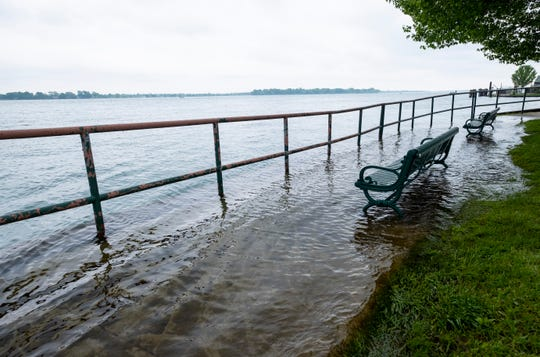 Water spills from the St. Clair River over a public walkway Wednesday, June 5, 2019 in Marine City. Because more water is being added through precipitation than is being removed through evaporation, Lake Huron and the St. Clair River are seeing much higher than usual levels, which is leading to localized flooding and erosion along the shoreline.