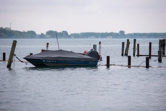 A fishing boat is tied to a dock that sits even with the surface of the St. Clair River Wednesday, June 5, 2019 in Marine City. Because more water is being added through precipitation than is being removed through evaporation, Lake Huron and the St. Clair River are seeing much higher than usual levels, which is leading to localized flooding and erosion along the shoreline.