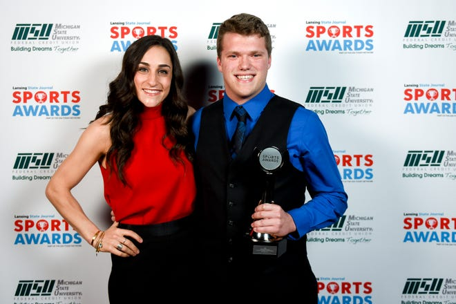 I Am Sport Award winner Fowlerville's Alec Johnson, right, poses with guest speaker Olympic gold medalist Jordyn Wieber during the Lansing State Journal Sports Awards on Tuesday, June 4, 2019, at the Wharton Center in East Lansing.