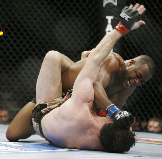 Rashad Evans connects with a right to Forrest Griffin during the third round of their UFC light heavyweight mixed martial art match Saturday, Dec. 27, 2008 at The MGM Grand Garden Arena in Las Vegas. Evans won in the third round by TKO.