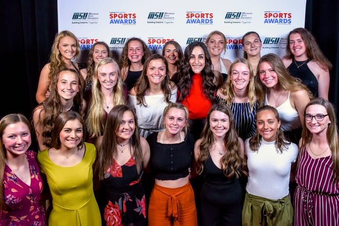 Top Team Award Eaton Rapids softball team members pose with guest speaker Olympic gold medalist Jordyn Wieber during the Lansing State Journal Sports Awards on Tuesday, June 4, 2019, at the Wharton Center in East Lansing.