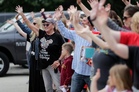 Cathi Burish and Riverview teachers wave goodbye as buses take students home on the final day of school at Riverview Early Learning Center Wednesday, June 5, 2019, in Manitowoc, Wis. Joshua Clark/USA TODAY NETWORK-Wisconsin