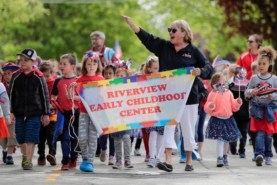 Principal Cathi Burish leads students from the Riverview Early Childhood Center in the Memorial Day parade Monday, May 27, 2019, in Manitowoc, Wis. Joshua Clark/USA TODAY NETWORK-Wisconsin
