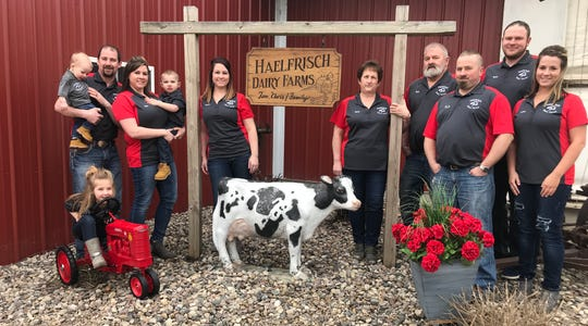 Members of the Haelfrisch family work hard to coordinate their dairy farm through strong family bonds and strong work ethics.