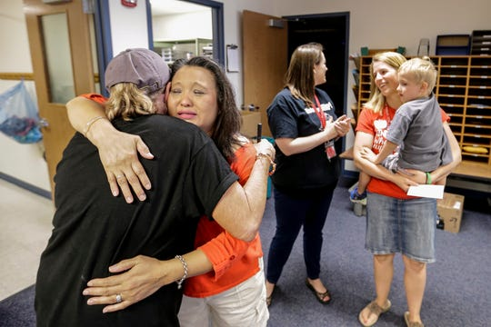 Kia Kue gives a tearful goodbye to principal Cathi Burish during the final day of school at Riverview Early Learning Center Wednesday, June 5, 2019, in Manitowoc, Wis. Joshua Clark/USA TODAY NETWORK-Wisconsin