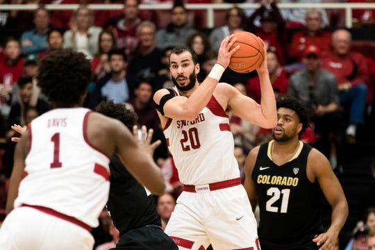 Stanford center Josh Sharma (20) gets a rebound against Colorado in the second half of an NCAA college basketball game in Stanford, Calif., Saturday, Jan. 26, 2019. Stanford won 75-62. (AP Photo/John Hefti)