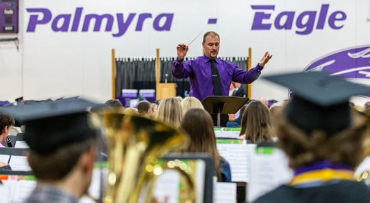 Band Director Scott Hein leads the Palmyra-Eagle High School band through a performance during the Class of 2019 Commencement Ceremony at the school June 2. The upcoming school year could be the last for this cash-strapped district.