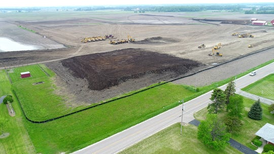 Earth movers and construction equipment are in place as site preparation work continues for Foxconn Technology Group's planned flat-screen factory in Mount Pleasant.