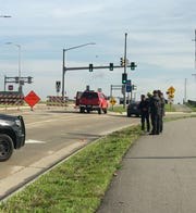 Investigators gather Wednesday at Highway 67 and I-94 near where a standoff occurred on Tuesday.