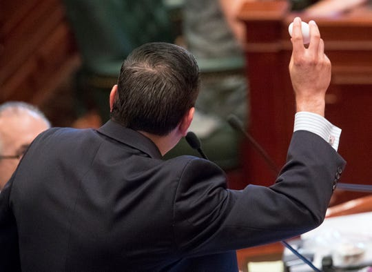 "Illinois state Rep. Anthony DeLuca, D-Chicago Heights, holds up an egg before cracking it into a pan to reference the ""This is your brain on drugs,"" campaign during debate on a bill to legalize recreational marijuana use in the Illinois House chambers Friday, May 31, 2019. DeLuca voted against the bill that passed the House 66-47."