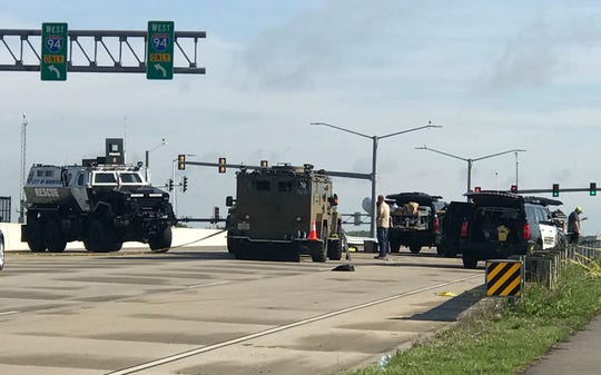 Emergency response vehicles from various law enforcement agencies are stationed Wednesday on Highway 67 near I-94 where a standoff occurred Tuesday night. Authorities continued their investigation at the site on Wednesday morning.
