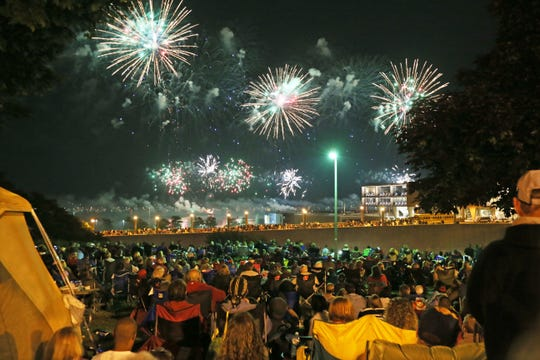 People watch the U.S. Bank fireworks from the bluff along N. Prospect Ave in 2015.