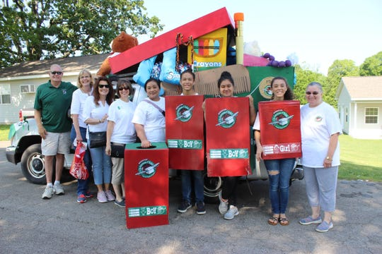 North Central Arkansas Operation Christmas Child recently won second place in the Gassville in the Park parade. Pictured are (left to right) Roger Newman, Cheryl Newman, Regional Director Vicki Pepper, Area Coordinator Shari Alexander, Rosie Davenport, Ethan Davenport, Bradlynn Davenport, Emma Davenport and Lana Colley. Operation Christmas Child is a division of Samaritan's Purse, an international relief organization. Shoeboxes full of toys, school supplies, hygiene items are sent to children in over 100 countries that normally would not receive a gift at Christmas as a way to share the Good News of Jesus Christ. For more information about Operation Christmas Child, visit www.samaritanspurse.org/occ. For more information about the North Central Arkansas team, visit their Facebook page: OCC North Central Arkansas.
