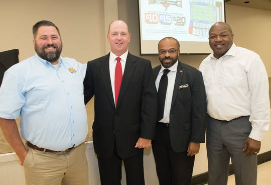 Louisiana Tech football coach Skip Holtz (left center) and Grambling State football coach Broderick Fobbs (right center) with MedCamps of Louisiana executive director Caleb Seney (left) and Ruston Boys and Girls Club chief professional officer Eldonta Osborne.