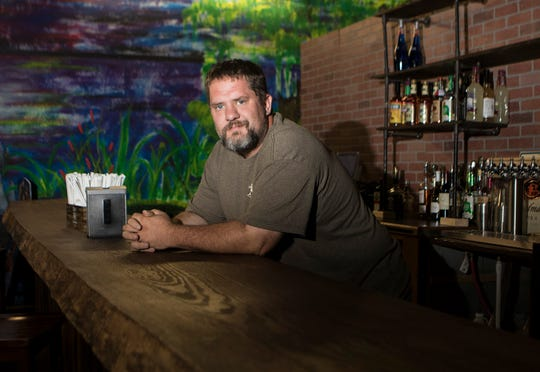 Mitch Bratton poses for a portrait at the new location of The BackYard Street Food & Pub off of Mane St. in West Monroe, La. on June 5. The new location will feature a mini-golf course, arcade and the restaurant. Bratton intends on opening the restaurant next week Friday.