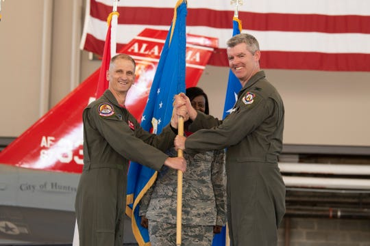 Col. Edward Casey, the incoming commander of the 187th Fighter Wing and previous vice commander of the 187th FW, assumes command from Brig. Gen. Randal Efferson, Alabama Assistant Adjutant General for Air and Air Component Commander May 31, 2019, during the 187th FW change of command ceremony held in the hangar on Dannelly Field, Ala. Casey followed Col. William Sparrow as 187th FW commander.