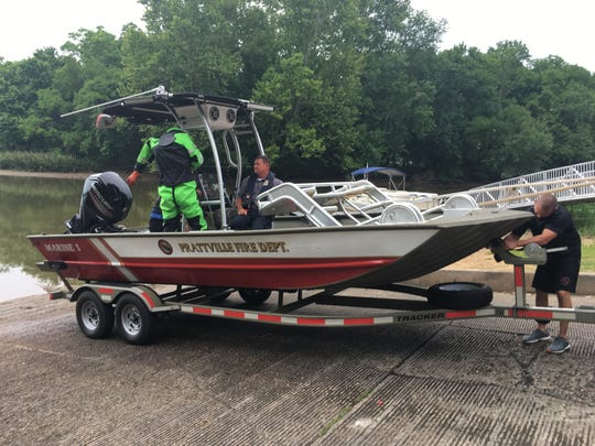 A rescue boat prepares for the search at Cooters Pond.