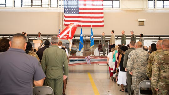 Attendees stand for the National Anthem May 31, 2019, during the 187th Fighter Wing change of command ceremony held in the hangar on Dannelly Field, Ala. Col. Edward Casey, previous vice wing commander, assumed command of the Red Tails.