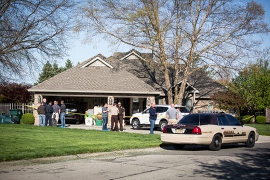 Authorities at the scene of an apparent double murder-suicide on Timothy Way on April 28