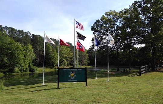 New sign, flag poles and flags at the Veterans Memorial Park at Evergreen Lake in Fairview were installed just before 2019 Memorial Day weekend.
