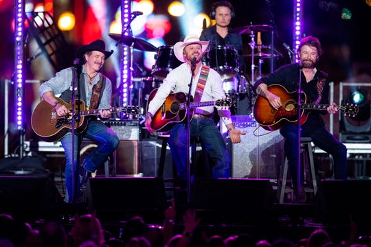 Brooks & Dunn perform with Cody Johnson during CMT Crossroads on a stage built on Broadway Tuesday, June 4, 2019, in Nashville, Tenn.