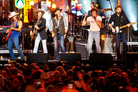Brooks & Dunn perform with Midland during CMT Crossroads on a stage built on Broadway Tuesday, June 4, 2019, in Nashville, Tenn.